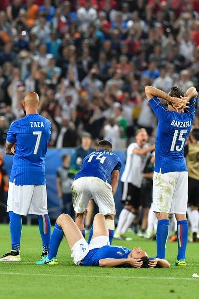 Italy's players react after the Euro 2016 quarter-final football match between Germany and Italy at the Matmut Atlantique stadium in Bordeaux on July 2, 2016.  / AFP / GEORGES GOBET