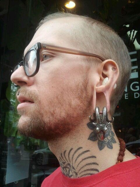 John Logger wearing our Baphomet ear weights in White ...