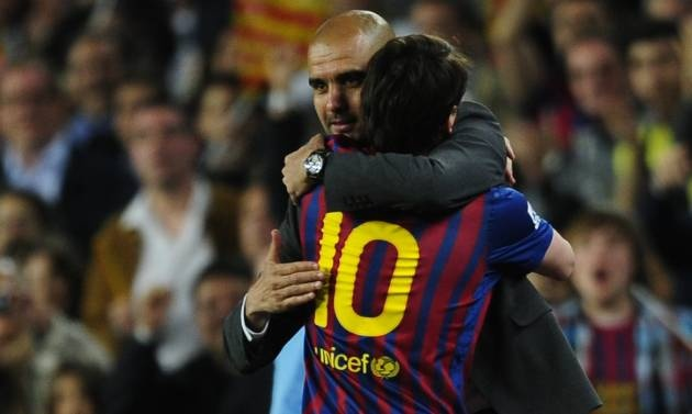Lionel Messi scores his 50th goal in the Primera División in the 2011/12 season, and hugs Pep Guardiola who was in charge of F.C. Barcelona for the last time at Camp Nou.