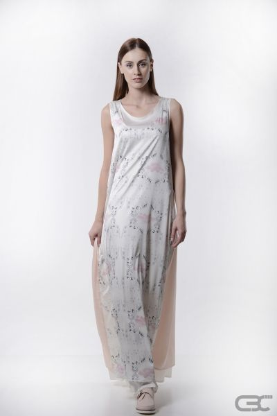 http://cbcdesign.ro/en/shop/rochie-evening-wind/  Dress composed of two layers: the outer layer has digitally printed front and misty rose back, the inner layer is white voile. Flowy and soft, the dress forms a sweet look, but it can easily become sporty with a pair of converse and a hoodie-vest or sophisticated with stilettos and statement earrings.