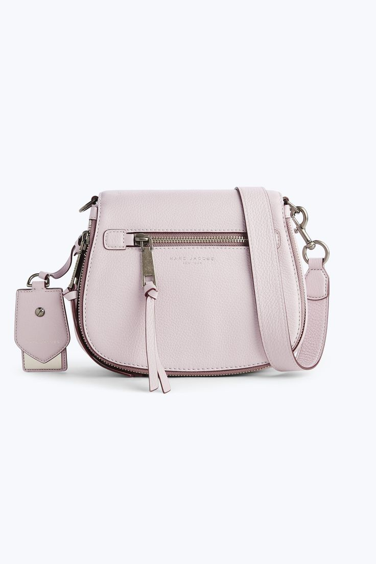 """Marc Jacobs, """"the Recruit Small Nomad is the compact carryall to covet. Luxe tumbled leather meets gilded hardware with an interior full of compartments - And voilà, the bag of your dreams""""."""