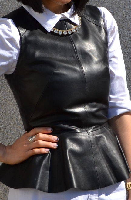 Wear this leather peplum top with a white blouse and it's good enough for work and funky enough not to be plain