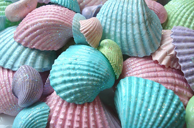 Collect sea shells at the beach or purchase some. Paint them different pastel colors and use fabric glue to glue them to a basic bra. Lovely look. Could be used as bathing suit.