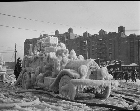 Fire and Ice. Boston Fire Truck encased in ice after a fire in the North End, around 1920