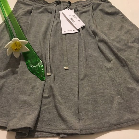 Lacoste Skirt A classic made from lightweight rayon with just enough stretch; designed with large pleats that make this tennis silhouette so iconic. Pair it with a polo and sneakers for effortless athletic style on or off the court or a sexier top and heels for a carefree evening out . 67% Lyocell (Rayon), 33% Cotton. Classic! Lacoste Skirts Mini