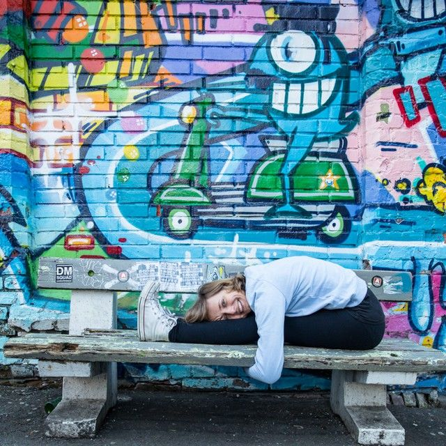 Forward bend on the bench with huge smile, graffti, yoga yoga time