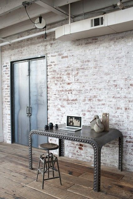 white washed brick + studded metal table