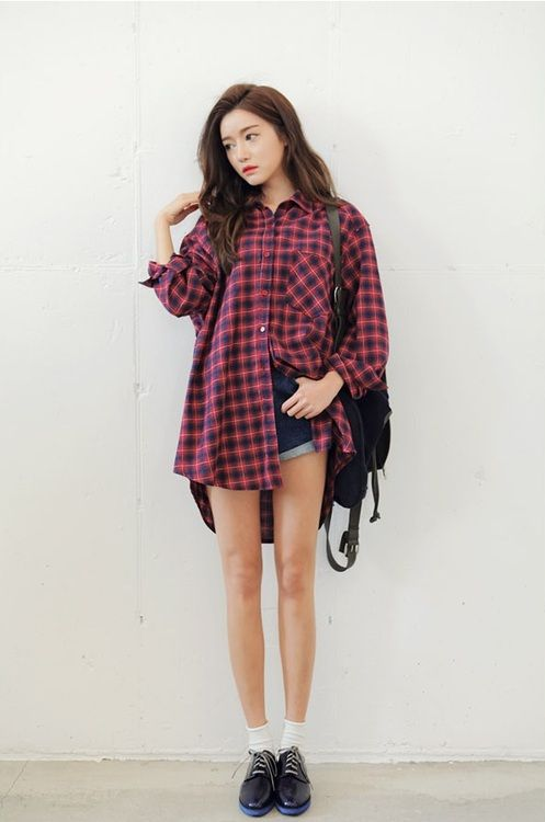 Red longline flannel shirt, high waisted denim jeans, black backpack, black lace-up shoes.