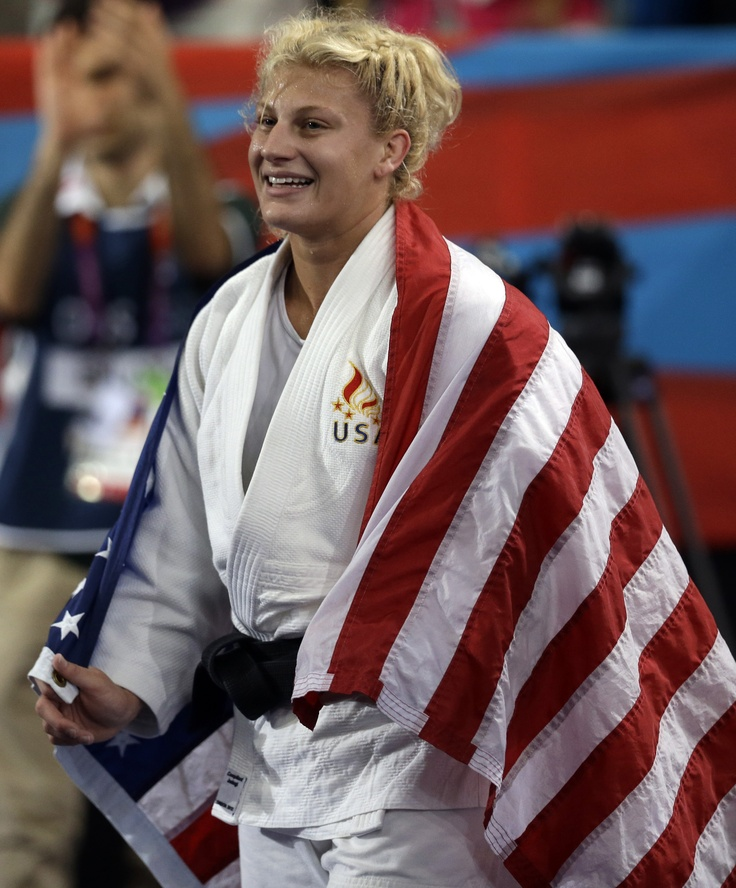Kayla Harrison of the United States celebrates after winning her match against Gemma Gibbons of Great Britain for the United States' first Olympic gold medal in judo during the women's 78-kg judo competition.