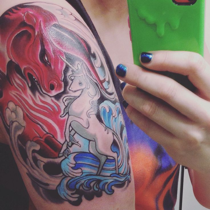 The last unicorn vs the red bull tattoo by chris bettley for Grand rapids mi tattoo