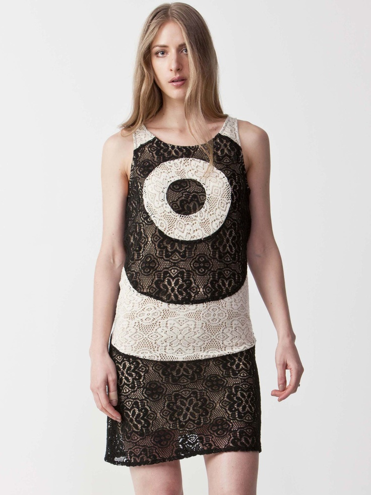 Valerie - Contrast embroidered Dress with round neckline.  Sleeveless styling with circular embroidery design.  Enclosed side zip and regular fit cut. $77.00