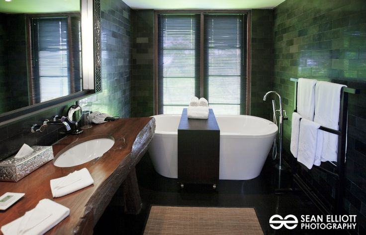 During his tour of Umah Raja, Sean Elliott caught this wonderful shot of the guest bathroom. We love the green reflection on the black stone!