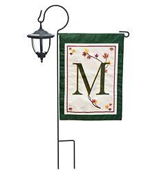 Address Garden Flag Stand . $14.99. Address Garden Flag Stand. Our elegant Fall Leaves Monogram Garden Flag will bring beauty and distinction to any home. Adorned with textured leaves, embroidery, and a bold green border, these flags make a big statement from the street. This double sided, fade-resistant flag sets your house apart from the rest. Durable polyester with appliqued design and embroidered stitching. Imported. Garden sized fall flag with leaves and single initial F...