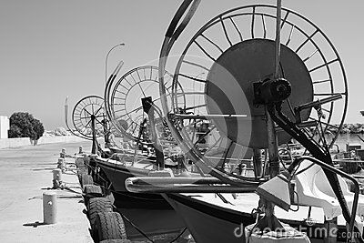 Fishing boats with special devices on a bows at the pier after fishing in Larnaca. Cyprus, Greece