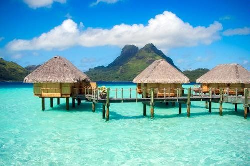 Overwater bungalows in Bora Bora, French Polynesia. More info: http://travel.yahoo.com/ideas/10-trips-of-a-lifetime.html (Photo: Frommers.com Community) #travel