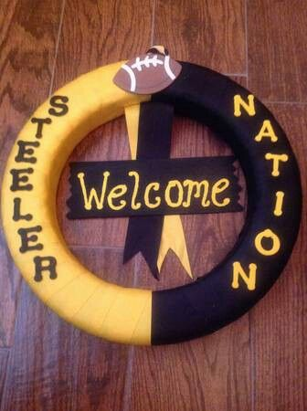 """Steeler Fans support your team with this handcrafted wreath. Made with black and yellow ribbon applied to a foam wreath form. Accented with wooden letters that read """"STEELER NATION"""" a wooden football and a handcrafted Wecome sign that completes this wreath."""