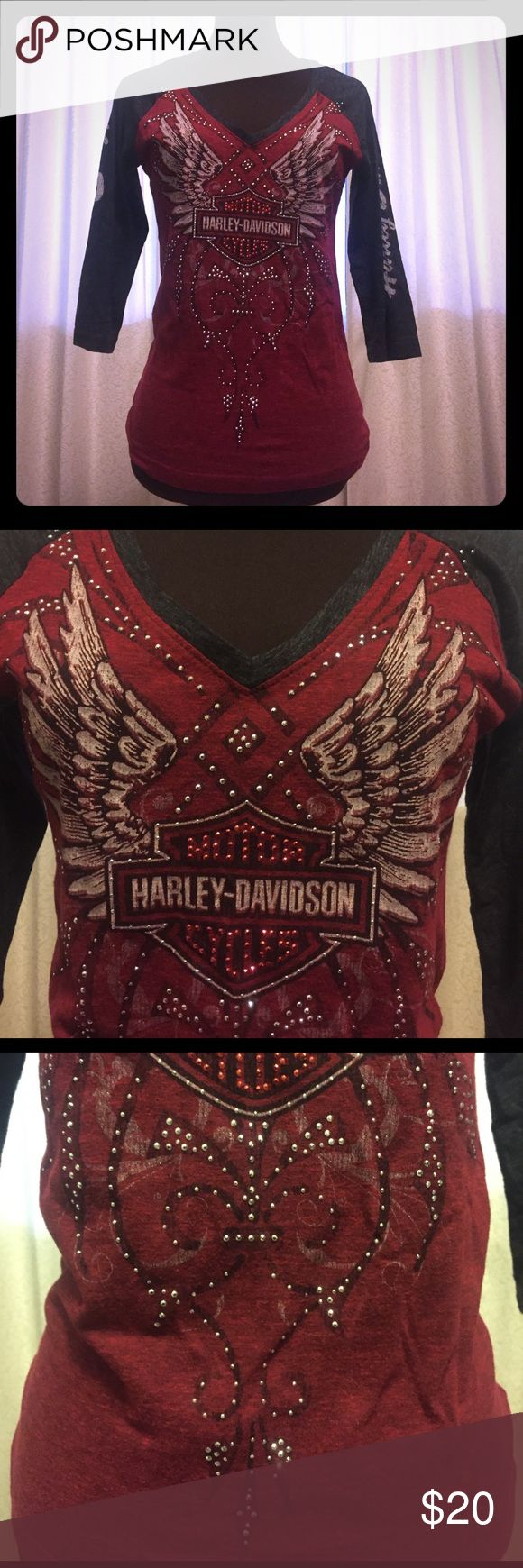 "NWOT: H-D Burgundy & Charcoal T-shirt - 3/4 Sleeve NWOT: Cool & feminine Harley Davidson ladies burgundy and charcoal 3/4 Sleeve t-shirt with silver Metallic sequin accents. Booth sleeves say ""Harley Davidson"" and the shirt is from Sturgis South Dakota dealership. Got as a gift, but too small. 50% polyester, 38% cotton, 12% rayon. Harley-Davidson Tops Tees - Long Sleeve"
