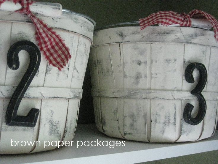 Spray painting and 'weathering' busshel baskets for storage! It sets a cute country feel that can look great anywhere and the baskets can be found at garage sales for pretty cheep! Such a cute idea!