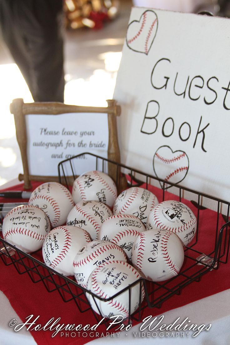 #BaseballWedding Baseball themed wedding. A unique guestbook... signed baseballs instead of a paper book. Wedding Photography. Hollywood Pro Weddings Videography and Photography.