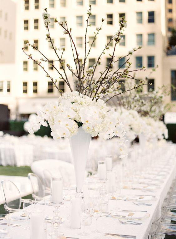 Orchid and hydrangea wedding centerpieces. | Centerpieces | Flowers | Wedding Decor | #flowers #weddingdecor #centerpieces | www.starlettadesigns.com/