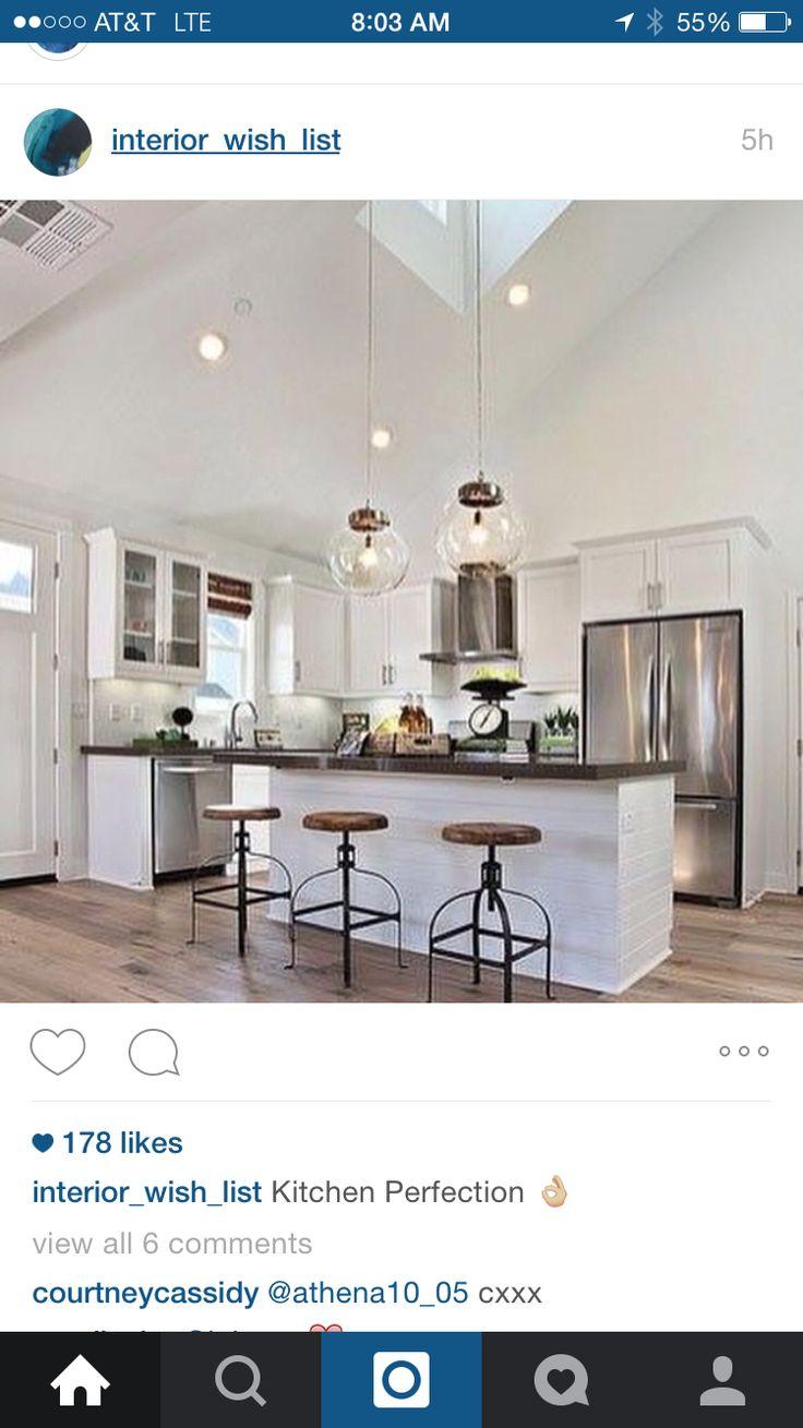L shaped kitchen design with skylight accenting