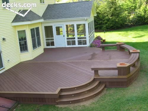 Trex round deck custom benche flower boxes round stairs for Circular garden decking