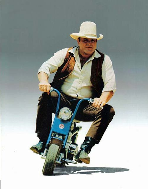 "Dan Blocker, who played Hoss Cartwright on ""Bonanza"", riding a minibike, c.1970"