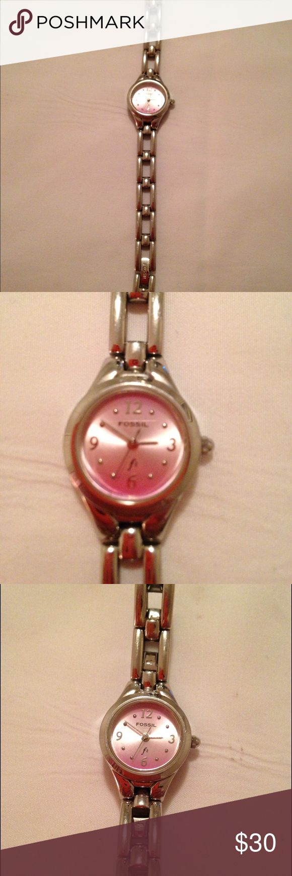Womens silver band fossil watch Womens fossil watch . Made for a woman with small wrist . Beautiful light pink face . Brand new battery and a couple scratches on the back plate where the battery goes . In perfect condition . Fossil Accessories Watches