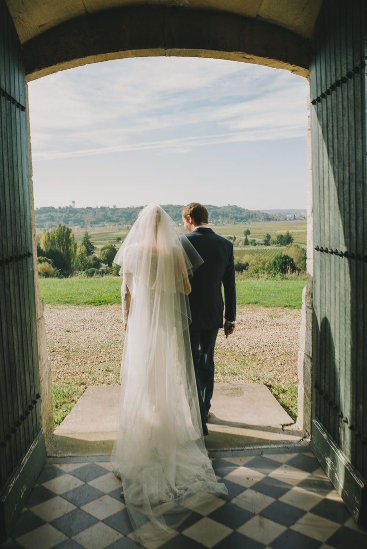 Image by Modern Vintage Weddings - Lusan Mandongus wedding dress, Jenny Packham headpiece & Jimmy Choo shoes at a destination wedding in a Chateau in France amongst the vineyards of Bordeaux with groom in a Reiss suit