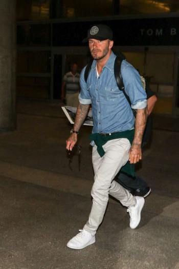 David Beckham in all white Adidas Stan Smith sneakers.
