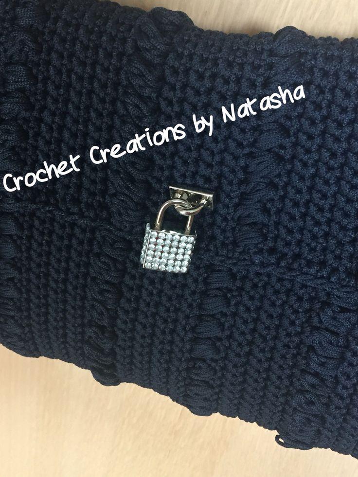 Detail: dark blue crochet bag with silver details