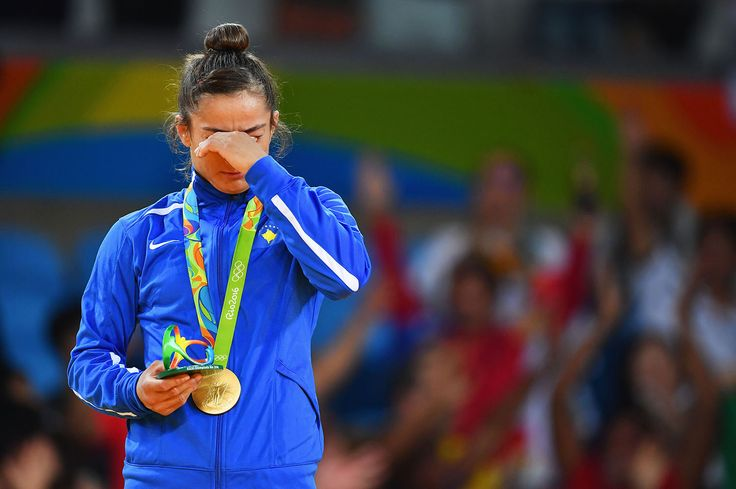 Gold medalist Majlinda Kelmendi shows her emotions during the medal ceremony for…