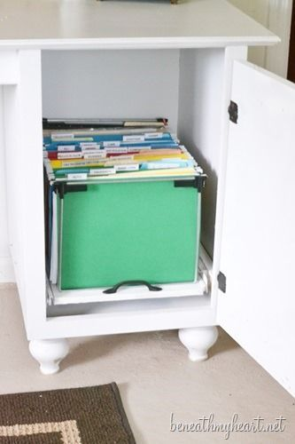 Pull-out shelf for files or one right near the top for laptop