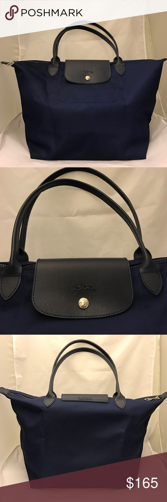 Longchamp Large Le Pliage Neo Nylon Tote Navy Blue Longchamp Large Le Pliage Neo Nylon Tote Navy Blue  Like new condition. 100% authentic.   12.25W x 11.75H x 7.5D (Interior: Large)  Leather in very good condition.   Nylon in very good condition. 1 of 4 corners is lightly scuffed. All other corners are in perfect condition.   Interior is in good condition.   Feel free to ask any questions. Longchamp Bags Totes
