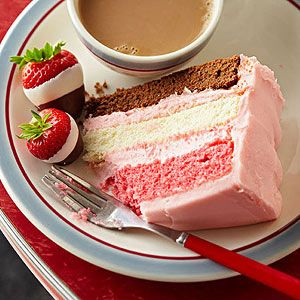 Neapolitan Party Cake -  This crowd-pleaser is easier than it looks. (You only make one batter.) Garnish the strawberry-frosted cake with double-dipped berries to hint at the festive stripes hiding inside. Though named for Naples, it is American.