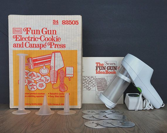 Sears Fun Gun Electric Cookie and Canape Press dated 1976. Original box and instruction booklet included! Includes: -Original box -Instruction booklet -Fun Gun -9 Cookie Discs -Decorator Tip -Filler Tip -Barrel Loader Great for MORE than just cookies! Create the perfect mints,