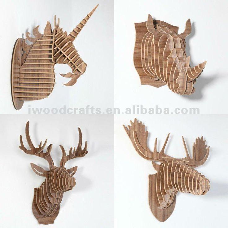 Wood animals on wall: unicorn, rhino, reindeer