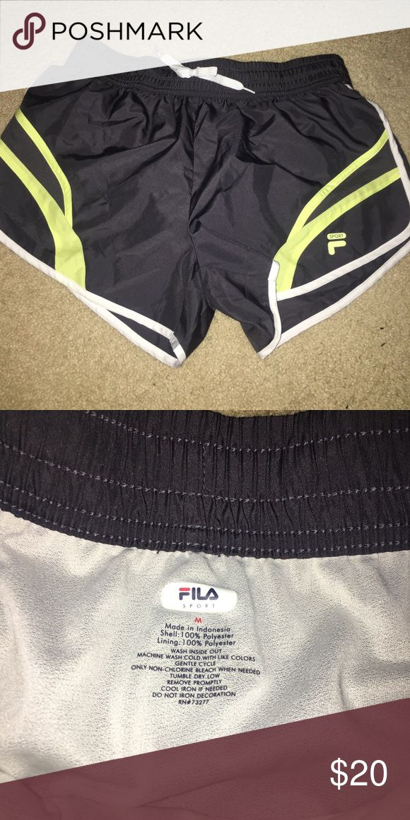 Fila shorts NWOT Workout shorts with mesh inside. Gray with neon yellow/green details. New without tags. Fila Shorts