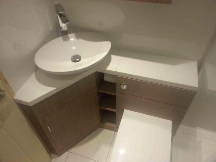 photo of bespoke neutral colours white corian oak dovcor bathrooms bathroom with basin white tiles and cabinet corner unit furniture