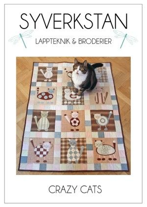 Quilt med katt-applikationer