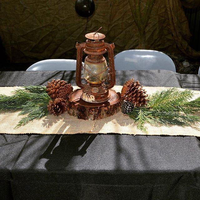 #lumberjackparty #lanterncenterpiece #pineconedecor #rusticcenterpiece
