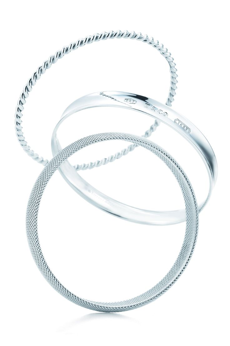 The right circles: Tiffany bangles in sterling silver. #TiffanyPinterest #silverbracelets #braceletstack