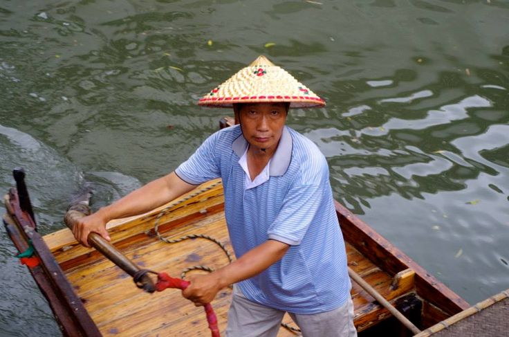 Man in Suzhou canal. Photo by Kayla Hedman. July 2013.