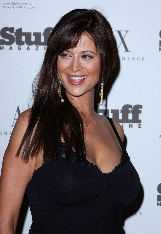 Catherine Bell | Breast-length hair in a simple haircut .