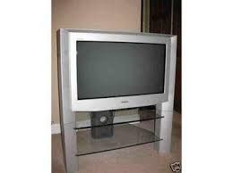 I already have this sony tv silver and a glass or maybe plastic tv stand, I think £0