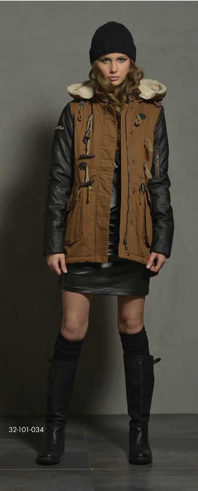 Ladies' jacket with detachable hood & immitation leather quality in sleeve portion. www.biston.gr