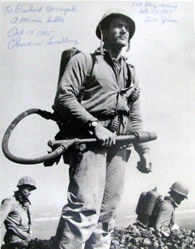 Cpl. Charles Lindberg carried a flamethrower. He was one of the six Marines who raised the first American flag over the historic Iwo Jima battlefield. Years later he was still unhappy about the lack of recognition the first flag-raisers received for their efforts
