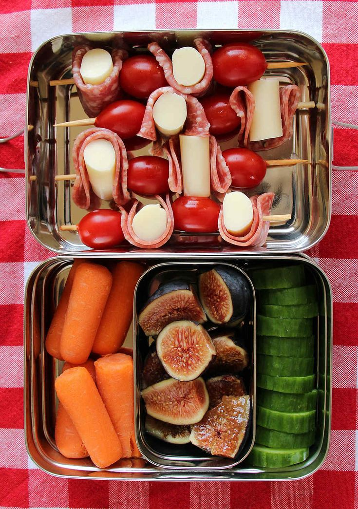 Antipasti Skewers | Martha Stewart Living - Thread chunks of kid-pleasing string cheese, slices of salami and cherry tomatoes onto skewers to make antipasti sticks. Fill the rest of the lunch box with carrots, fresh figs and cucumber slices.