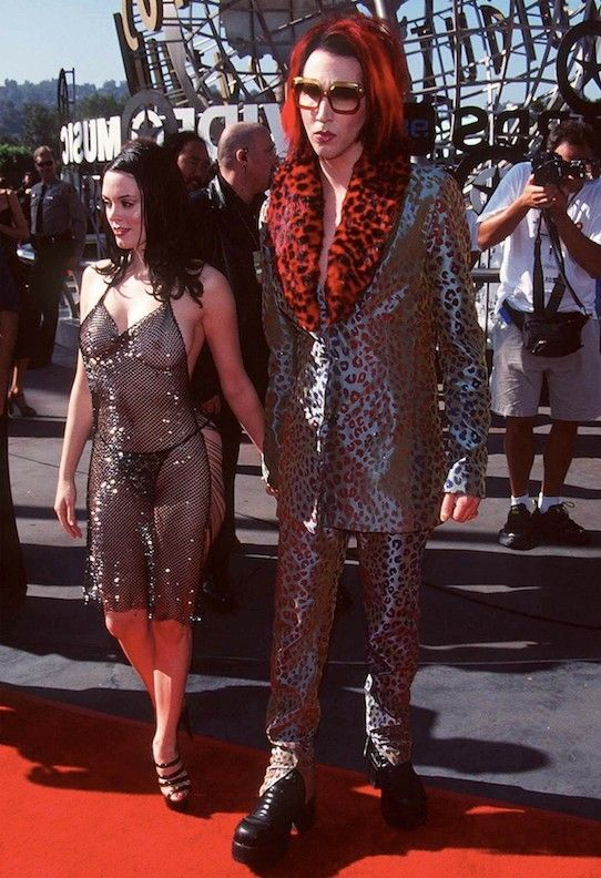 Rose McGowan on the 1998 red carpet with Marilyn Manson, in our top ten Rose McGowan fashion moments. More images here: http://www.dazeddigital.com/fashion/article/19311/1/rose-mcgowan