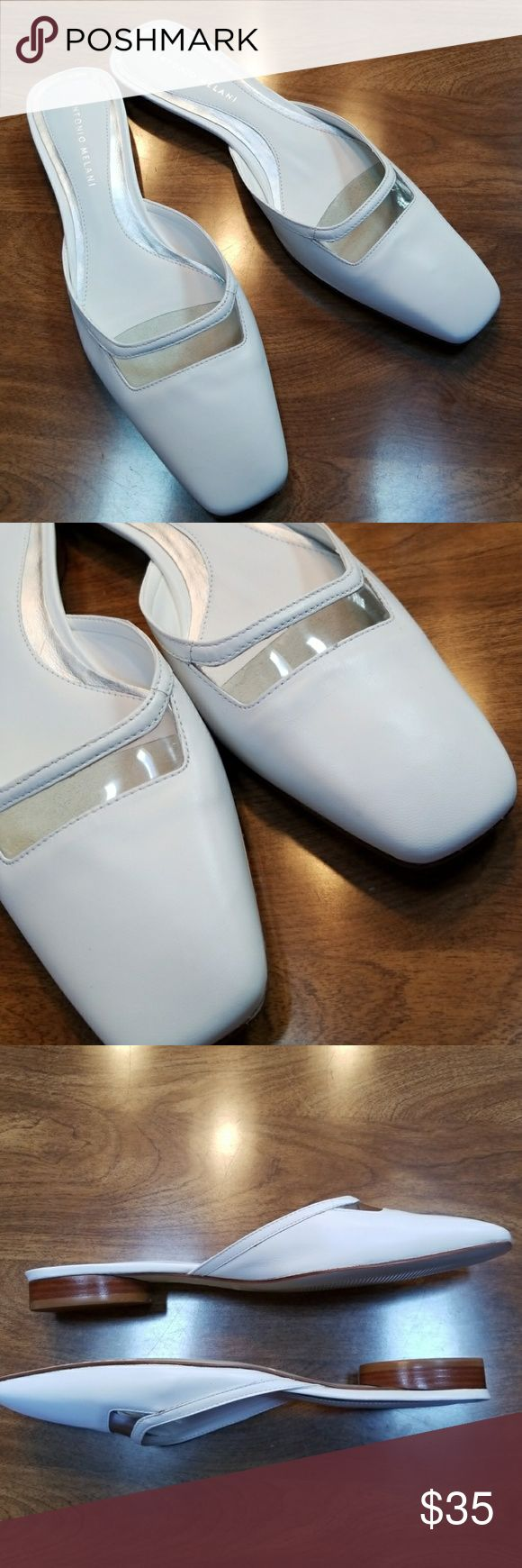 Antonio Melani White Kitten Heel Slip Ons These Shoes Are NEW and have Never Been Worn !   Fashion and Comfort in these White Leather slip on Antonio Melani Low Kitten Heel Made In Brazil Square toe Sophisticated Clear Peek a boo accent on top  Didi Model Glove fit Size 9 M  ✔BUNDLE UP FOR SAVINGS ✔ Antonio Melani Shoes Flats & Loafers